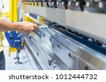 operator working cut and... | Shutterstock . vector #1012444732