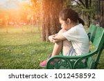asian girl in the park... | Shutterstock . vector #1012458592