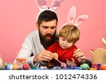 father and son preparing for... | Shutterstock . vector #1012474336