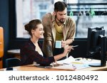 two workers helping each other  ... | Shutterstock . vector #1012480492