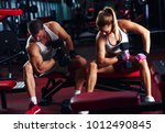 fitness couple exercising with... | Shutterstock . vector #1012490845