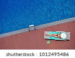 enjoying suntan. vacation... | Shutterstock . vector #1012495486