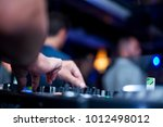dj's hands playing music on the ... | Shutterstock . vector #1012498012