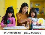 asian teacher and preschool... | Shutterstock . vector #1012505098