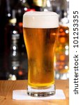glass of beer in a bar | Shutterstock . vector #101253355