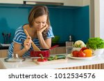 dissatisfied woman cooking and...   Shutterstock . vector #1012534576