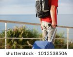 young man traveling with... | Shutterstock . vector #1012538506