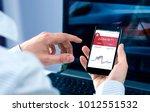 man checks bitcoin rates at... | Shutterstock . vector #1012551532