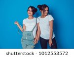attractive women in a white t... | Shutterstock . vector #1012553572