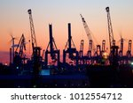 silhouette of container gantry... | Shutterstock . vector #1012554712