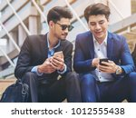two business people discuss... | Shutterstock . vector #1012555438