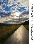 road to sunset sky | Shutterstock . vector #1012578622