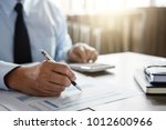 male accountant calculations... | Shutterstock . vector #1012600966