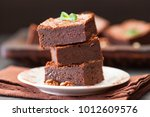 chocolate brownie square pieces ... | Shutterstock . vector #1012609576
