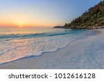 sunrise in marble beach ... | Shutterstock . vector #1012616128