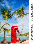 red phone booth in dickenson's... | Shutterstock . vector #1012625386
