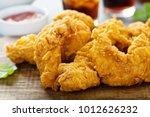 breaded chicken tenders with... | Shutterstock . vector #1012626232