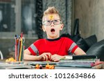 the little boy was thinking ...   Shutterstock . vector #1012634866
