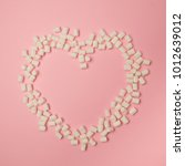 white tasty marshmallows in... | Shutterstock . vector #1012639012