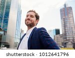 successful young businessman... | Shutterstock . vector #1012641796