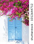 old blue door and pink flowers  ... | Shutterstock . vector #1012644712