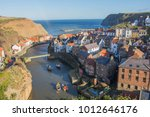 staithes harbour in north... | Shutterstock . vector #1012646176