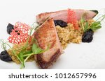 grilled duck served with prunes ...   Shutterstock . vector #1012657996