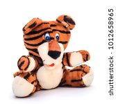 funny soft toy striped orange... | Shutterstock . vector #1012658965