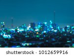 blurry bangkok night view with... | Shutterstock . vector #1012659916