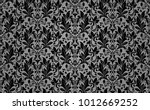floral pattern. wallpaper... | Shutterstock .eps vector #1012669252