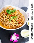 kao soi or thai curry noodles... | Shutterstock . vector #1012671136