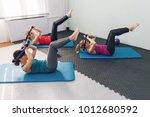 three women doing pilates... | Shutterstock . vector #1012680592
