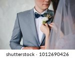 the bride's hand puts on a... | Shutterstock . vector #1012690426