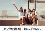 hen party on the rooftop. bride ... | Shutterstock . vector #1012695292