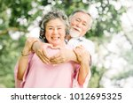 happy smile senior asian couple ... | Shutterstock . vector #1012695325