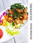 thai basil fried chicken with... | Shutterstock . vector #1012696582