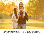 family playing in autumn park... | Shutterstock . vector #1012710898