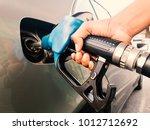 Hand Holding Gasoline Nozzle...