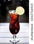 lemon thai iced tea in tall... | Shutterstock . vector #1012716415