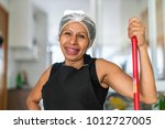 latin woman house cleaner... | Shutterstock . vector #1012727005