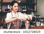 barista holding coffee in... | Shutterstock . vector #1012728025