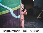 dirty plastic naked baby doll... | Shutterstock . vector #1012728805