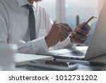 businessman in white shirt... | Shutterstock . vector #1012731202