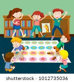 kids playing twister in room... | Shutterstock .eps vector #1012735036