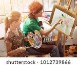 artist painting easel in studio....   Shutterstock . vector #1012739866