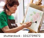 artist painting easel in studio....   Shutterstock . vector #1012739872