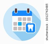 calendar page with human tooth... | Shutterstock .eps vector #1012742485