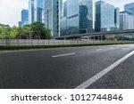empty urban road and modern... | Shutterstock . vector #1012744846