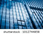 clouds reflected in windows of... | Shutterstock . vector #1012744858