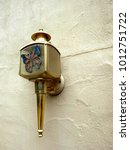 Small photo of Tacky vintage Old Town Wall Light outdoors in the garden